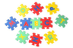 Alphabet puzzle pieces Stock Image
