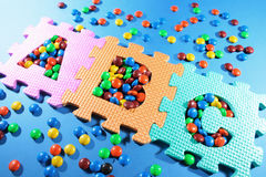 Alphabet Puzzles and Chocolate Lollies stock images