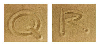 Alphabet Q-R on sand Stock Photography