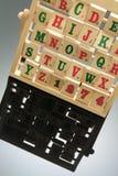 Alphabet Rack. Wooden Alphabet Rack with Reflection Stock Image