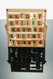 Alphabet Rack. Alphabets on Rack with Reflection Royalty Free Stock Photos