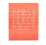 Alphabet on the red notebook Royalty Free Stock Photo