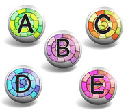 Alphabet on round badge Royalty Free Stock Photography