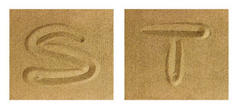 Alphabet S-T On Sand Stock Photos