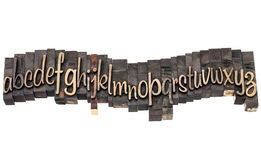 Alphabet in script wood type. English alphabet in wavy row - letterpress wood type printing blocks, a script font Stock Photos