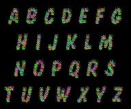 Alphabet set of colorful dots letters on black Stock Photos