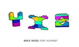 Alphabet set created from playing bricks. Royalty Free Stock Photos