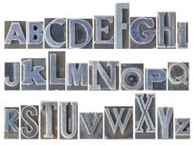 Alphabet set in mixed metal type. English alphabet set - a collage of 26 isolated letters in letterpress metal type printing blocks, a variety of mixed fonts stock photography