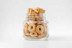 Alphabet shaped biscuits in bottle with white background. Royalty Free Stock Photo