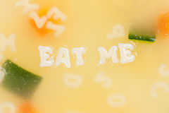 Alphabet soup drawing the words Eat Me Stock Photos