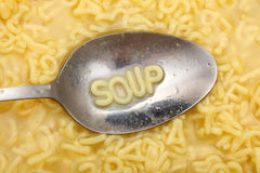 Alphabet Soup. Alphabet letters in spoon spell out Soup. Alphabet Soup Pasta. Close-up royalty free stock photo