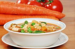 Alphabet soup with vegetables Stock Photo
