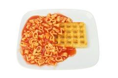 Alphabet spaghetti and waffle Royalty Free Stock Image