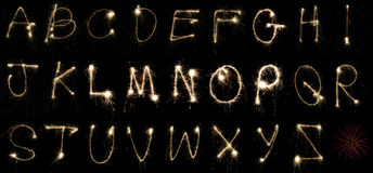 Alphabet Sparklers. The alphabet spelled out by hand using sparklers at night on long exposure. Can be cropped to spell out any word or celebratory message Royalty Free Stock Images