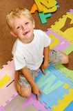 Alphabet student at playschool Stock Images