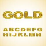 Alphabet stylized gold Stock Image