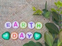 Alphabet-Tag der Erde-Wort auf Sackhintergrund Stockbilder
