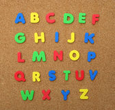 Alphabet A thru Z isolated on Cork Board. Colorful Alphabet A thru Z isolated on Cork Board Royalty Free Stock Photography