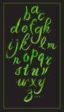 Alphabet tiré par la main réglé de calligraphie sur le noir watercolor Photographie stock libre de droits