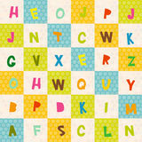 Alphabet  from A to Z seamless pattern. Polka dot background with green blue orange square. Vector Royalty Free Stock Image