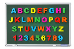 Alphabet Toy magnetic letters over blackboard. On a white background Royalty Free Stock Image