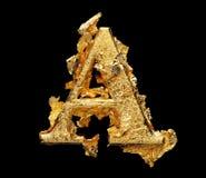 Alphabet und Zahlen im rauen Goldblatt Stockfotos