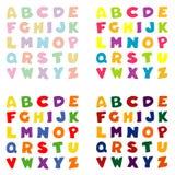 Alphabet in vier Farbenpaletten Lizenzfreie Stockfotos