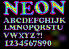 Alphabet in vivid neon design, uppercase letters, numbers, question and exclamation mark Stock Photography