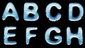 Alphabet from water isolated on a black background. stock footage