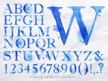Alphabet watercolor blue. Alphabet set drawn watercolor blots and stains with a spray blue color. Easily editable. Vector Stock Photos