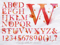Alphabet watercolor red. Alphabet set drawn watercolor blots and stains with a spray red color. Easily editable. Vector Stock Photo