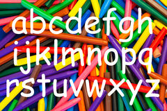 Alphabet. Wax Crayons with alphabet in lower case writing for nursery, kindergarten schools, education & teaching royalty free stock photos
