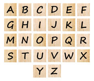 Alphabet on wood isolated on white background Stock Photos
