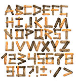 Alphabet from wooden boards and bark Royalty Free Stock Photos
