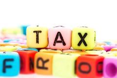 Alphabet  word cube of  TAX Stock Photo