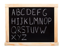 Alphabet written on blackboard Royalty Free Stock Photos