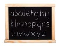 Alphabet written on blackboard Stock Photo