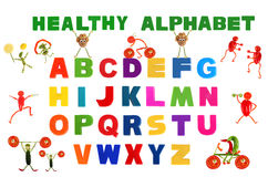 Alphabet written in multicolored plastic kids letters Royalty Free Stock Photos
