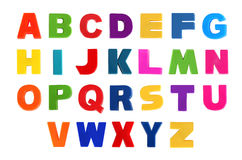 Alphabet written in multicolored plastic kids letters Stock Images
