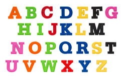 Alphabet written in multicolored plastic kids letters Royalty Free Stock Photography