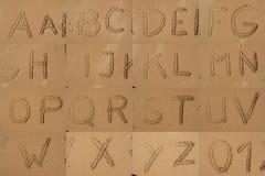 The Alphabet Written In Sand On A Beach. Royalty Free Stock Photos