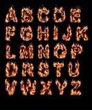 Alphabete mit Feuer Stockbilder