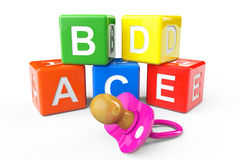 Alphabetical blocks and pacifier Stock Photography