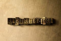 ALPHABETICAL - close-up of grungy vintage typeset word on metal backdrop Stock Photo