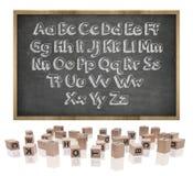 Alphabetkonzept auf Tafel mit Holzrahmen Lizenzfreie Stockfotos