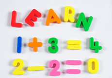 Alphabets. Learning magnet objects over white background Royalty Free Stock Images