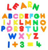 Alphabets. Learning magnet objects over white background Stock Photography