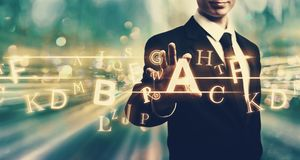 Alphabets with businessman Royalty Free Stock Image