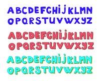 Alphabets d'écriture La police tirée par la main de griffonnage de vecteur a placé dans trois versions Photos stock