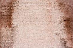 Alphabets de Khmer sur le mur antique Image libre de droits